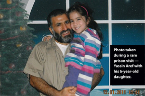 This photo of Yassin Aref and his 6-year-old daughter was taken during a rare prison visit.