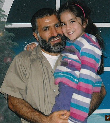 Yassin Aref holds his daughter during a rare prison visit